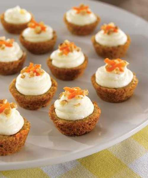 Recipe for Mini Carrot Cake Cups - Pile on the frosting! Our homemade, cream cheese icing makes these Mini Carrot Cake Cups irresistible!