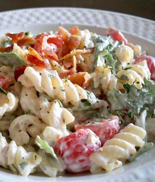 Recipe for BLT Pasta Salad - I humbly submit for your approval BLT Pasta Salad. It combines subtle herbs with peppery arugula and fresh tomatoes, all held together by a creamy base. Most importantly, it's finished with a modest portion of ever-delicious bacon