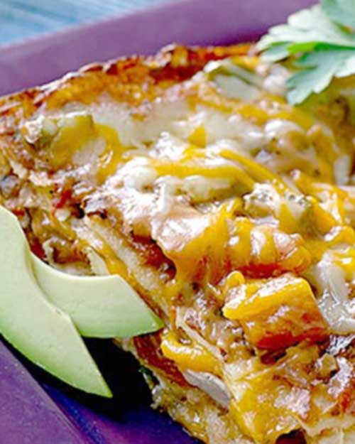 Recipe for Enchilada Lasagna - It's our classic one-dish wonder. This Mexican casserole is like a big fat lasagna, with layers of tortillas instead of the traditional noodles.