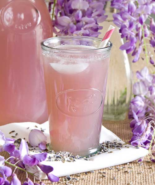 Recipe for Lavender Lemonade - Adding lavender gives your lemonade a beautiful pink colour without all the added food coloring and preservatives found in the store bought variety. It also adds a delicious floral flavor that perfectly complements spring. Enjoy!