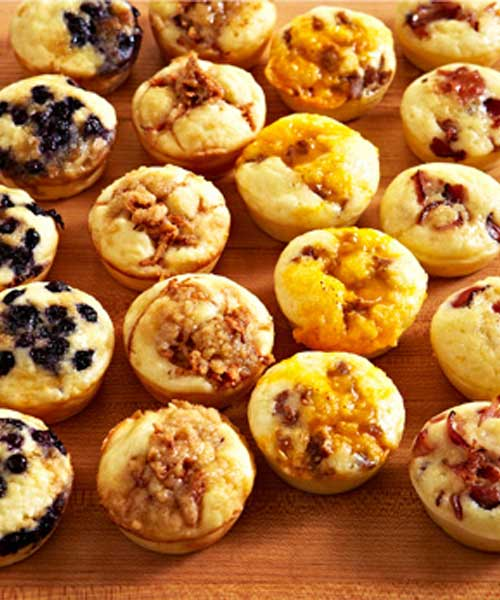 Recipe for Baked Pancake Muffins - A great make-ahead recipe for easy snacking, breakfast on the go, or packed with a side of maple syrup, these muffins are ideal for school lunches. Customize the add-ins to suit your family's tastes.