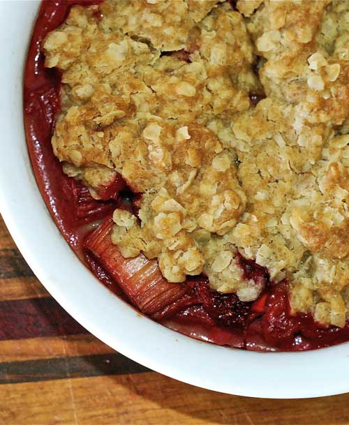 Recipe for Strawberry Rhubarb Crisp - The rolled oats really add a great heartiness to the dish, and a big scoop of vanilla ice cream is the ultimate finishing touch. You'll notice that this recipe also calls for rhubarb, however, I left it out completely.