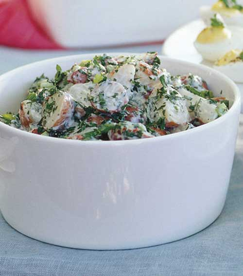 Recipe for Creamy Red Potato Salad with Lemon and Fresh Herbs - Sometimes you just want something different.. Red Potatoes are lower in starch than Yukon Golds or Russets, baby red potatoes hold their shape when tossed.