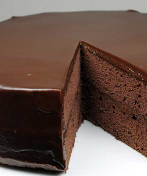 Recipe for Flourless Chocolate Cake with Chocolate Glaze - For devoted chocolate lovers' only! The ultimate chocolate indulgence, this moist and dense chocolate cake is topped with a smooth, rich dark chocolate ganache that melts in your mouth. Serve it with sweetened whipped cream and raspberries for a delightful and elegant desert.