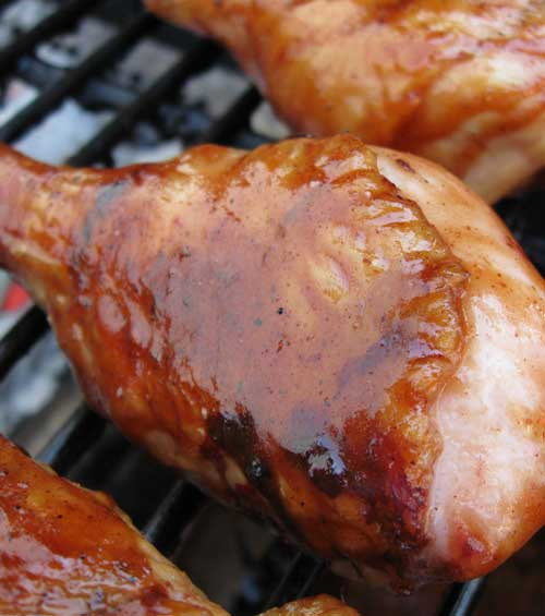 Recipe for BBQ Chicken Drumsticks Wrapped in Bacon - This is the PERFECT recipe for grilled chicken. It is my goto almost everytime we fire up the grill.