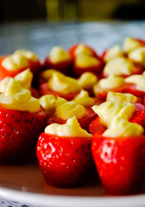 Recipe for Cheesecake Stuffed Strawberries - You'll love these guilt-free little cheesecake stuffed strawberries. So easy and perfect for spring or summer parties!