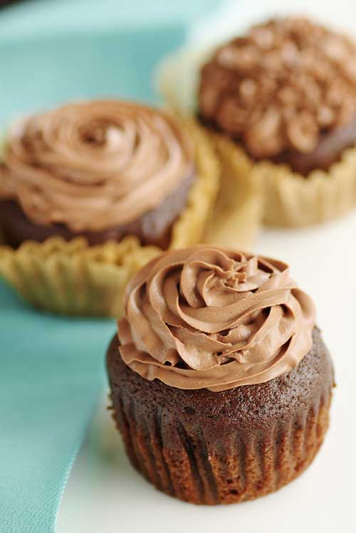 Recipe for Kahlua Cupcakes with Kahlua Chocolate Mousse Frosting - Kahlua and chocolate, two flavors that are perfect on their own. Combine the two and...good luck not eating all of these cupcakes on your own.