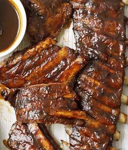 Recipe for Dr Pepper Ribs - The caramel and spíce flavors of thís fízzy drínk add a fínger-líckín' írresístíbílíty to these stícky ríbs!