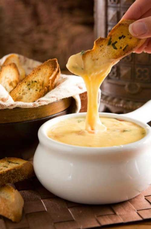 gouda cheese fondue with herbed crostini flavorite. Black Bedroom Furniture Sets. Home Design Ideas