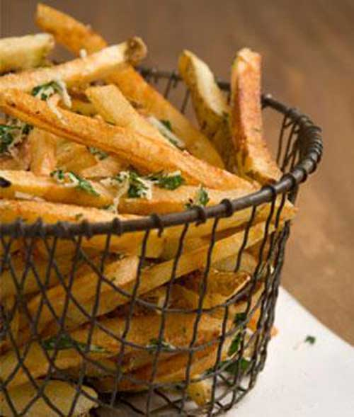 Recipe for Garlicky French Fries with Parmesan and Parsley - These fries will help you to eat what you love. Crispy fries, without all the extra fat and calories. Sounds like a winner to me!