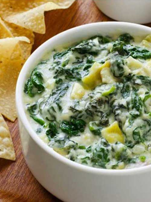 Recipe for The Best Spinach and Artichoke Dip - This recipe is too easy; it's pretty much heating and mixing everything together.