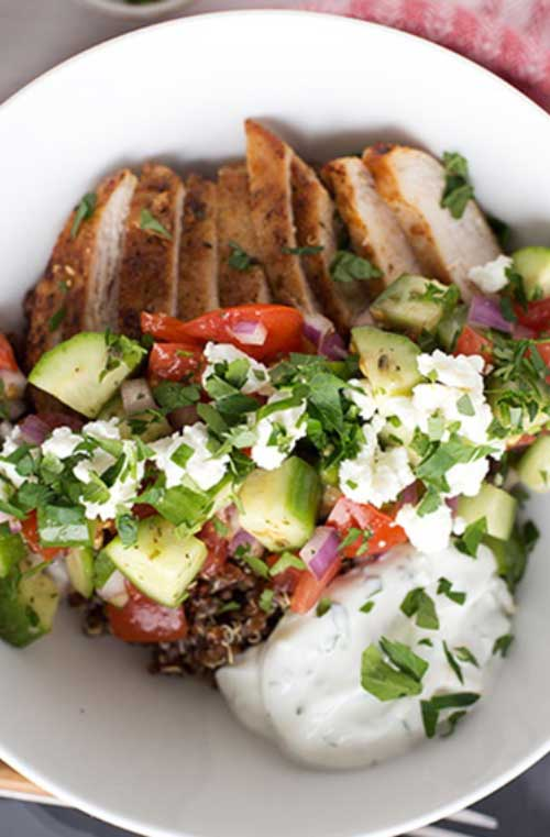 Recipe for Greek Chicken Quinoa Bowls - This is a quick and healthy meal to prepare for the family. This dinner has it all - whole grains, vegetables, lean protein and a light yogurt sauce.