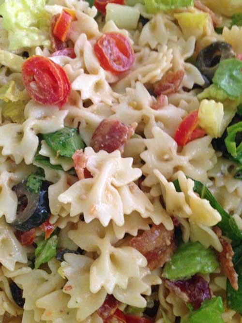 Recipe for Caesar BLT Pasta Salad - Not only are pasta salads easy to throw together, but they also feed big crowds and are a perfect side dish for just about everything.