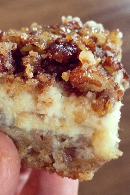 "Recipe for Pecan Cheesecake Squares - You can't go wrong with a layer of shortbread, a layer of cheesecake and a layer of pecan pie in every bite! My daughter calls them ""squares of heaven."" I think after you try them, you'll see why!"