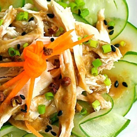 Recipe for Bang Bang Chicken - This is a refreshing dish of cucumbers and chicken topped with a nutty sauce spiked with Sichuan pepper.