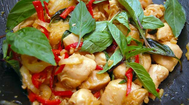 Recipe for Thai Basil Chicken - This is a healthy, Thai-influenced dish that isn't too spicy and has lots of texture, with the moist chicken and crunchy cashews.
