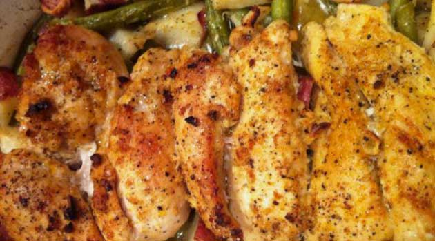 Recipe for Lemon and Garlic Chicken with Roasted Potatoes and Green Beans - The classic combination of lemon and garlic proves it's a winner yet again in this simple but elegant baked chicken dish.