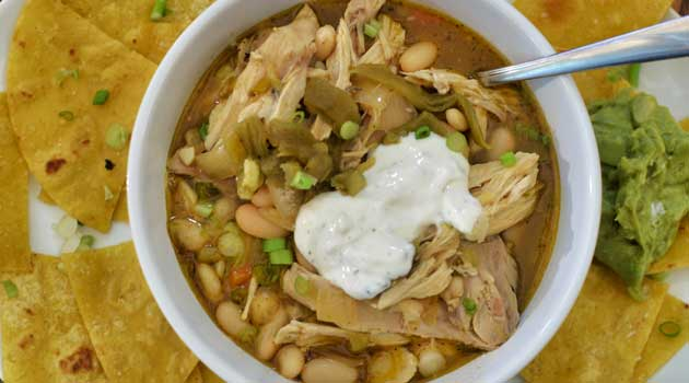 "Recipe for White Bean and Turkey Chili - One of those ""killer"" recipes that will wow any crowd, all while helping you use up that leftover turkey!"