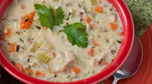 Recipe for Turkey with Wild Rice Soup - The rice and vegetables make this soup very filling and yet it's low-fat, which is also welcome after eating all that rich food last week.