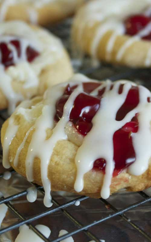 Recipe for Mini Cherry Cheese Danishes - What a simple and yet beautiful dessert. The crescent rolls are the perfect base for the sweet cream cheese and the tart cherries.