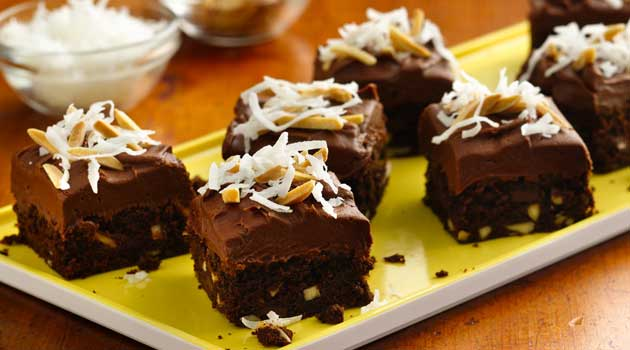 Recipe for Chocolate Chunk Almond Brownies - These indulgent buttery rich brownies accented with coconut and almonds, perfect for the holidays!