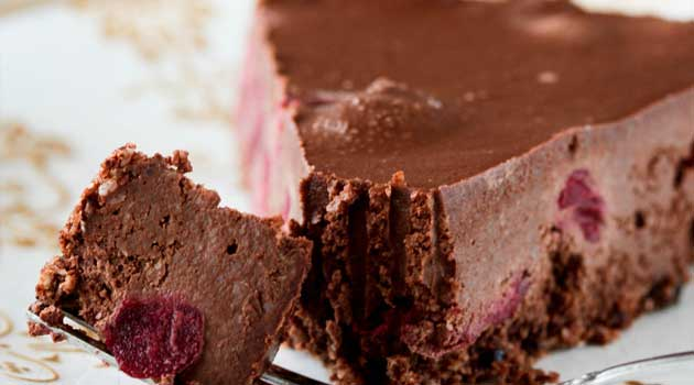 Recipe for Black Forest Chocolate Cheesecake - This cheesecake drew quite a knockout reaction when I made it, and I'm sure you can see why. It is bursting with sweet cherries layered between a chocolate crust and a creamy chocolate cheesecake filling.