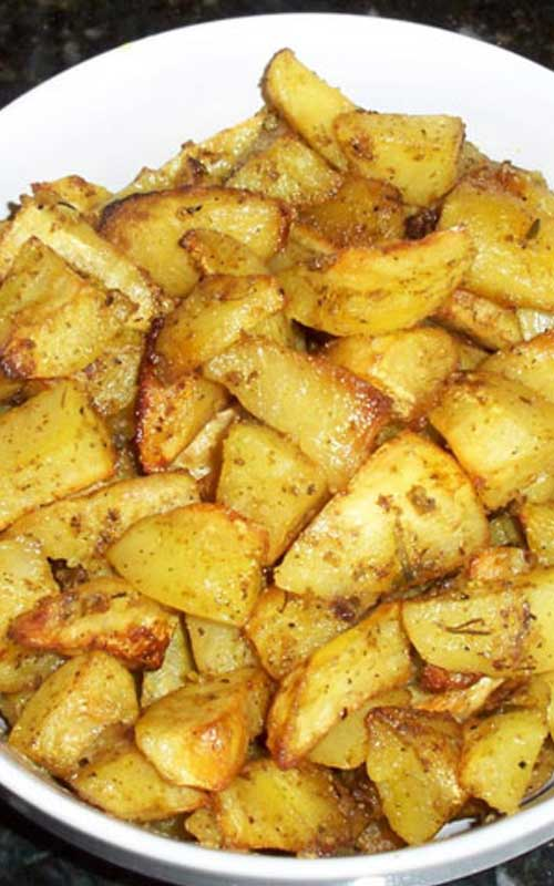 Recipe for Oven Roasted Garlic Potatoes - These roasted potatoes have become a family favorite. The potatoes roast slowly in a bath of lemon and olive oil, soaking up all the garlic-y goodness!