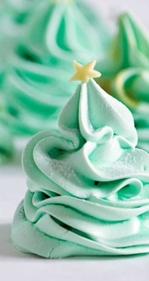 Recipe for Christmas Tree Meringues - The perfect little treat to serve up on Christmas. And they are better for you than cookies, so you don't have to feel bad when you eat more than one!