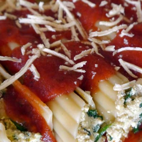 Recipe for Stuffed Spinach & Mushroom Manicotti - Bring on the wow factor with this traditional pasta dish. This spinach and mushroom manicotti recipe only looks like it takes a lot of effort to make!