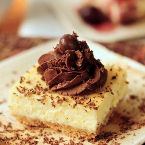 Recipe for Zabaglione Cheesecake - A rich, smooth, and delightful cheesecake combination set on an almond crumb base and glazed with a decadent trufle fudge frosting.