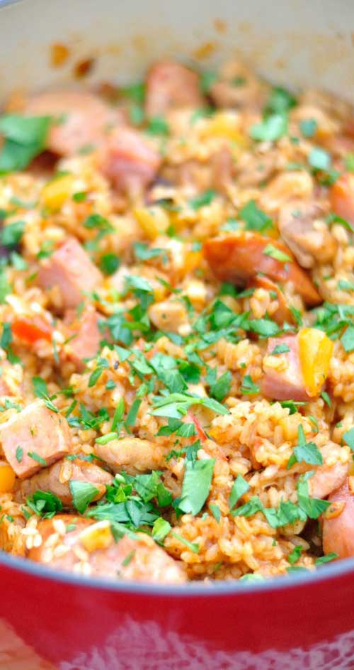 Recipe for Jambalaya with Chicken, Sausage, and Ham - This spicy dish will probably go over like gangbusters, but without leaving you with too many dishes to wash.