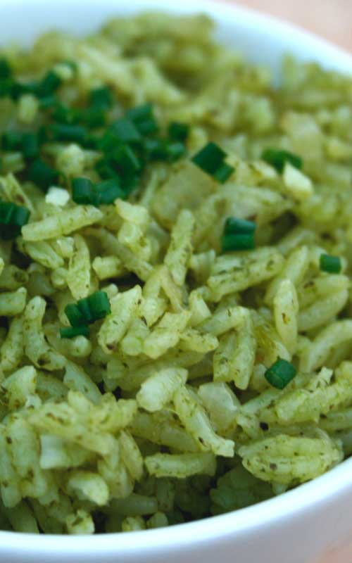 "Recipe for Garlic & Herb ""Green"" Rice - Nice Mexican twist on boring old rice. A good accompaniment for just about any main course, especially grilled meats."