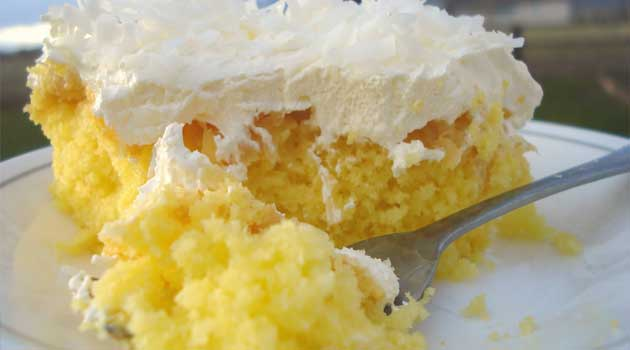 Recipe for Pineapple Coconut Cake - All the flavors go together deliciously! The cake is lemon, topped with crushed pineapple, a vanilla cream frosting, and sprinkled on top of that, shredded coconut. So YUM!