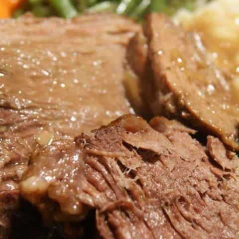 Recipe for Slow Cooker Pot Roast - Get a head start on dinner with this fresh take on a slow- simmered, all-in-one meal that makes clean-up a breeze.
