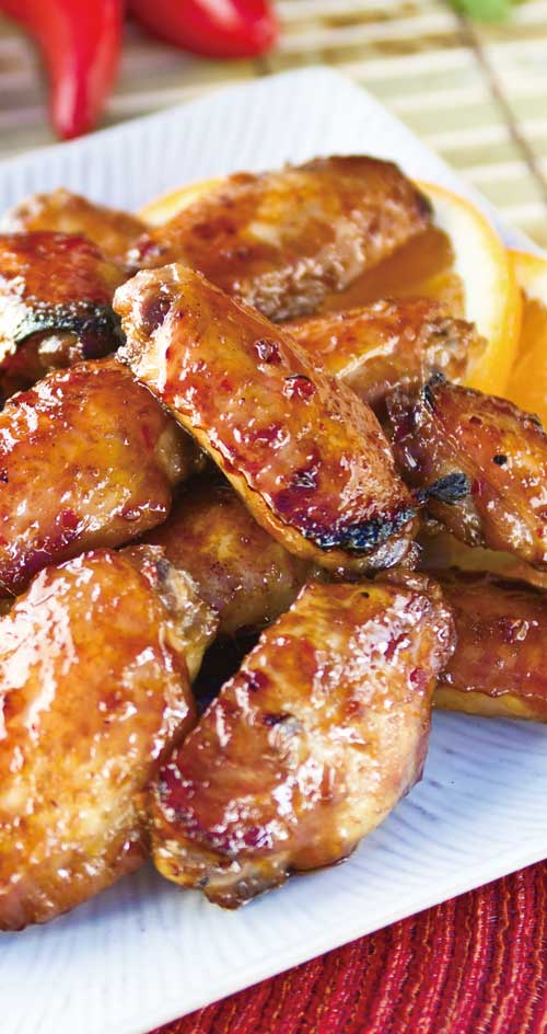 Recipe for Spicy Chicken Wings with Sriracha Chili Sauce - No Superbowl party food table would be complete without BBQ wings, and we simply love this spicy chicken wings recipe. And, they're easy to make!