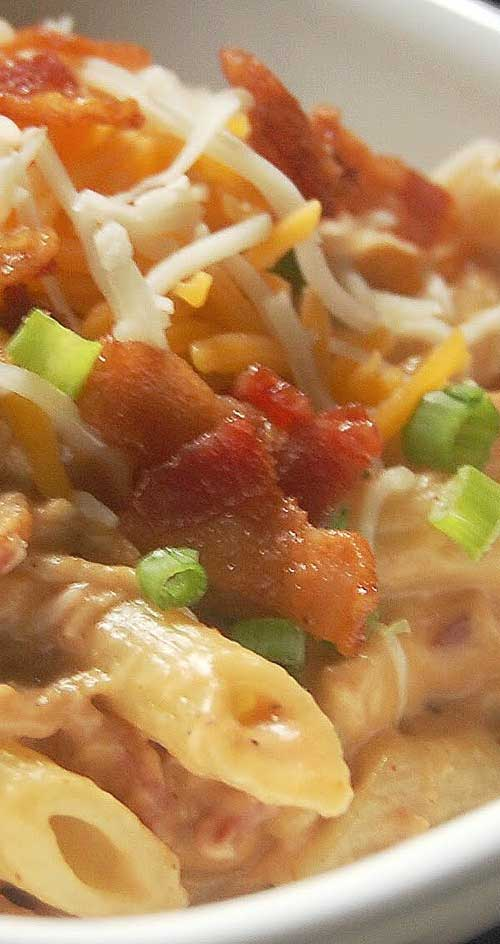 Recipe for BBQ Chicken and Bacon Pasta - It's smokey and creamy and cheesy. It's pure comfort food, and something that this barbecue-loving family will be indulging in frequently.