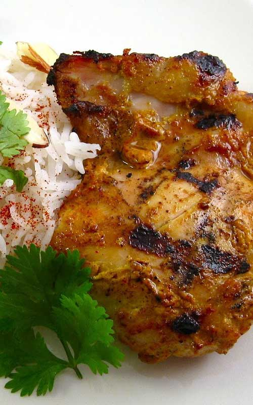 Recipe for Chicken Tikka on the Grill - Cooked either on a stovetop grill pan or over a flame, this chicken is incredibly succulent and flavorful - a fantastic alternative to your run-of-the-mill barbecue sauce.