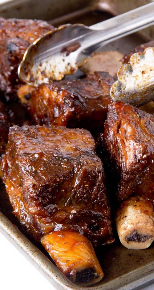 Recipe for Slow Cooker BBQ Short Ribs - These babies are so good there won't be leftovers! A little bit sweet with just the right amount of mustardy zest. If you're feeding a big crowd, double or triple the recipe.