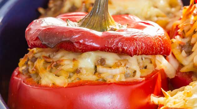 Recipe for Rice Stuffed Red Peppers - Here is a recipe for a meatless stuffed red pepper. Instead you have fresh mushrooms, onion, rice and two types of cheese.