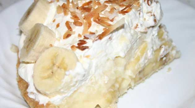 Recipe for Banana Cream Pie - This fluffy banana cream pie recipe is piled high with fresh ripe bananas and creamy vanilla filling, then topped with pillowy whipped cream and toasted coconut.