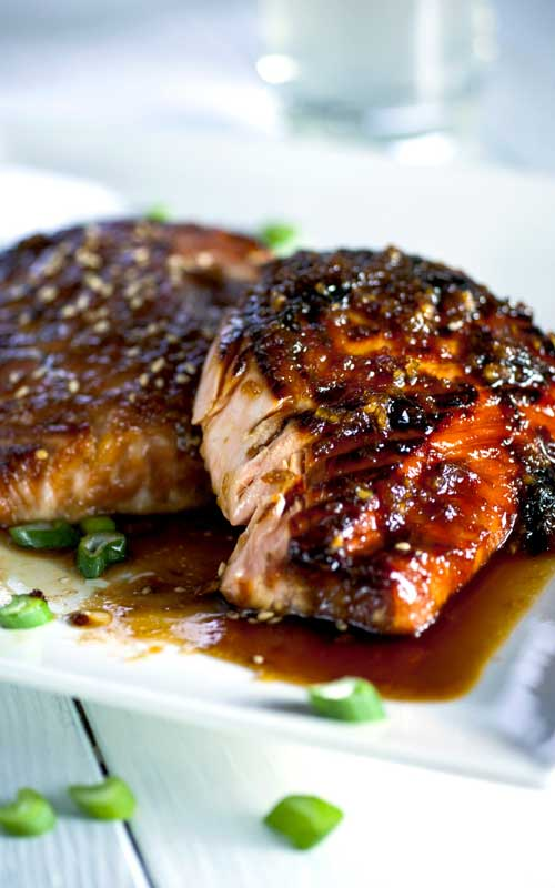 Recipe for Garlic and Miso Glazed Salmon - The easiest, most flavorful salmon you will ever make. Once you cut into your salmon filet you end up with lovely juicy and tender meat. It's almost like a piece of candy melting in your mouth.