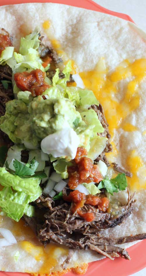 Recipe for Slow Cooker Mexican Shredded Beef - Oh my goodness this beef is good. I suspect it's much much better than Chipotle...because WOW, so much flavor! And tender and easy because you just throw it in the slow cooker.
