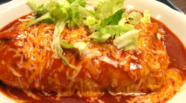 Recipe for Smothered Burritos - Very easy, yet very good smothered burritos. I got this recipe from a friend, and everyone I serve them to asks for the recipe.