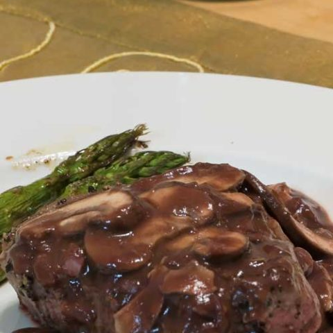 Recipe for Pepper Steak with Port Wine Mushroom Sauce - Slather pan-seared beef fillets with a homemade port-wine mushroom sauce for a easy but elegant entrée.