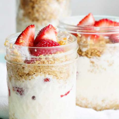 Recipe for Strawberry Lemonade Ice Cream Parfaits - I like to assemble and serve lemonade ice cream in jars, parfait style. Add fresh, juicy strawberries and graham cracker crumble for a fun summer dessert ready for entertaining, or to indulge at home after a day in the sun. Enjoy!