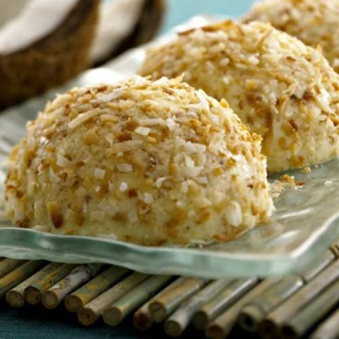 Recipe for Coconut Bavarians - The distinctive taste of coconut combined with the delicate flavor and rich, velvety texture of Crème Fraîche to create a bite sized sweet treat.