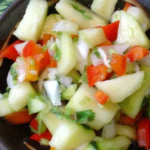 Recipe for Thai Cucumber Salad - If you love Thai food but prefer less spice, try this ultra-easy Thai-inspired cucumber and onion salad that's refreshing, not hot.