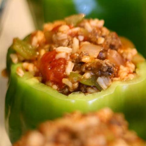 Recipe for Stuffed Peppers - What better way to get your veggies in than by eating stuffed peppers! Simple ingredients transform into a dish your entire family will enjoy.