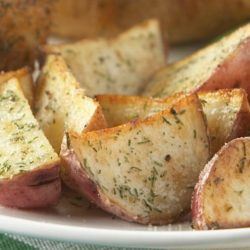 These Easy Dill Roasted Red Potatoes are an easy, delicious side dish especially when roasted alongside your chicken, beef or pork roast. The herbs used to season these potatoes are sure to make them stand above regular old spuds.