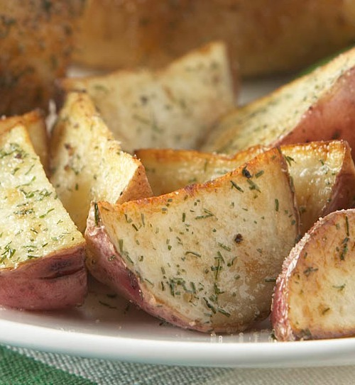 TheseEasy Dill Roasted Red Potatoes are an easy, delicious side dish especially when roasted alongside your chicken, beef or pork roast. The herbs used to season these potatoes are sure to make them stand above regular old spuds.